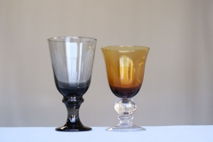 <h5>Colored Glassware</h5><p>Smoked Water Goblet, Amber Water Goblet </p>