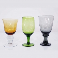 <h5>Colored Glassware</h5><p>Amber Water Goblet, Green Water Goblet, Smoked Water Goblet </p>